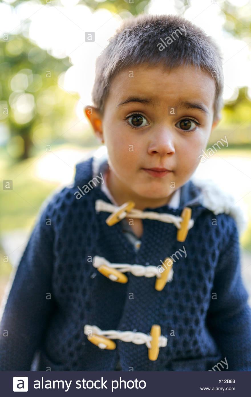Portrait of little boy with eyes wide open - Stock Image
