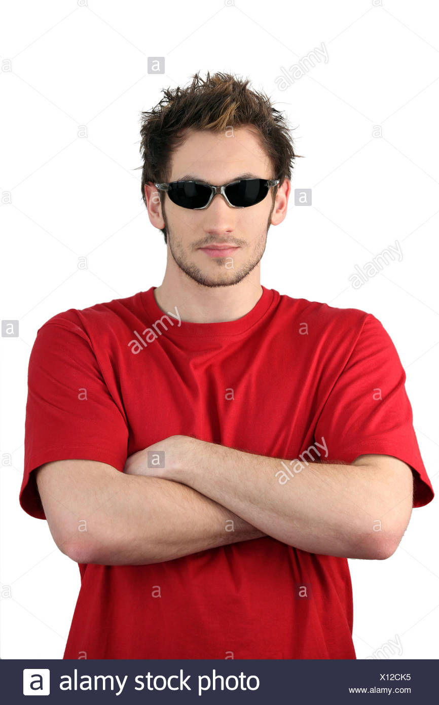 Young man wearing sunglasses - Stock Image