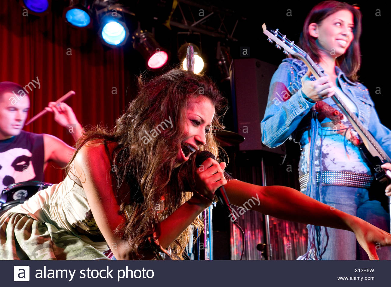 A young female singer performing - Stock Image