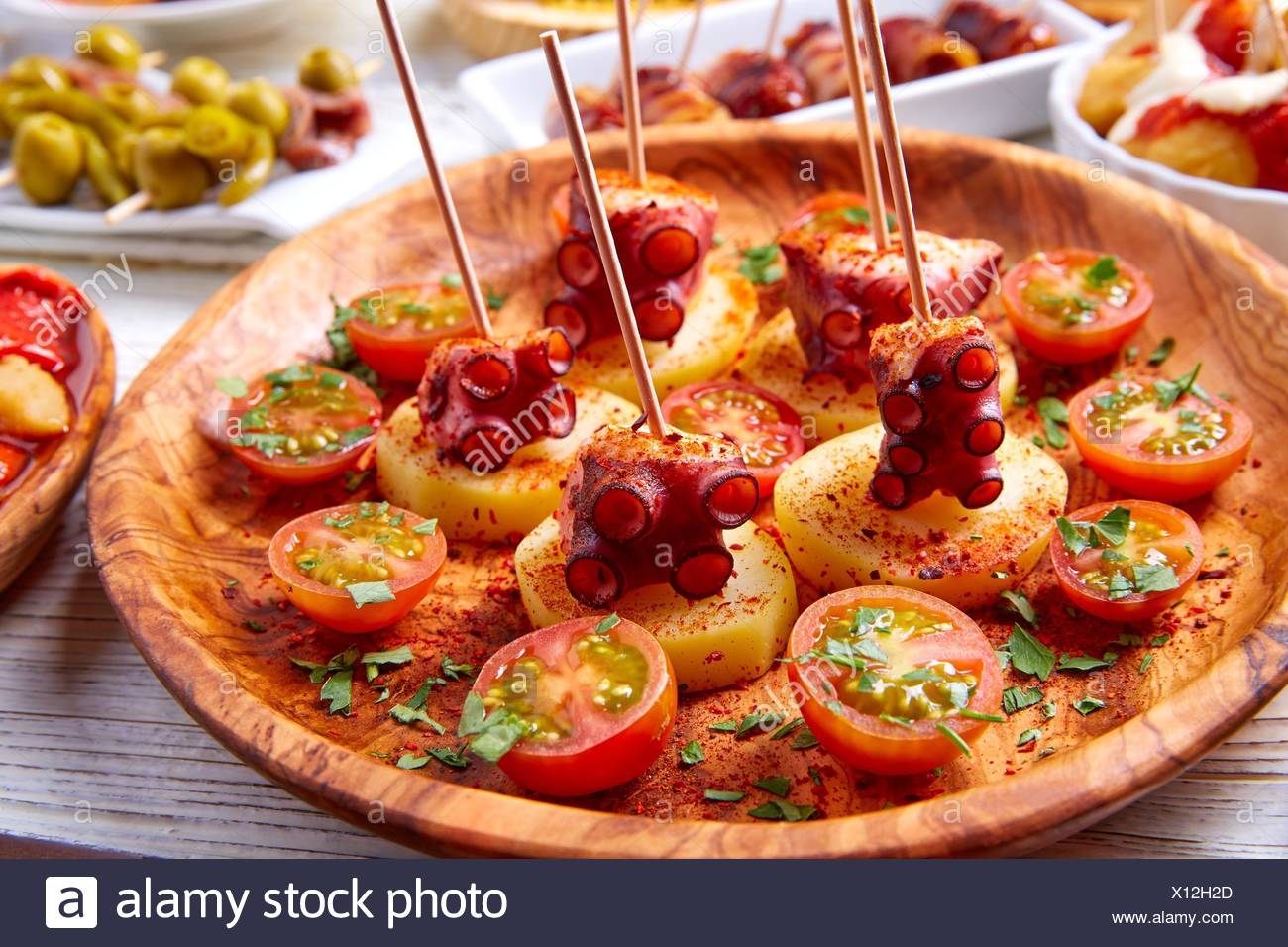 Galician Octopus a la Gallega tapas pinchos recipe from Spain with potatoes. - Stock Image