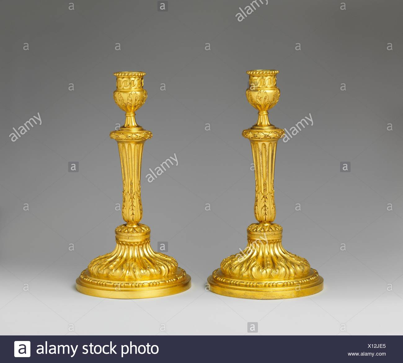 Pair of candlesticks. Date: ca. 1770-75; Culture: French; Medium: Gilt bronze; Dimensions: Overall (confirmed): 10 1/2 x 5 5/8 in. (26.7 x 14.3 cm); Stock Photo