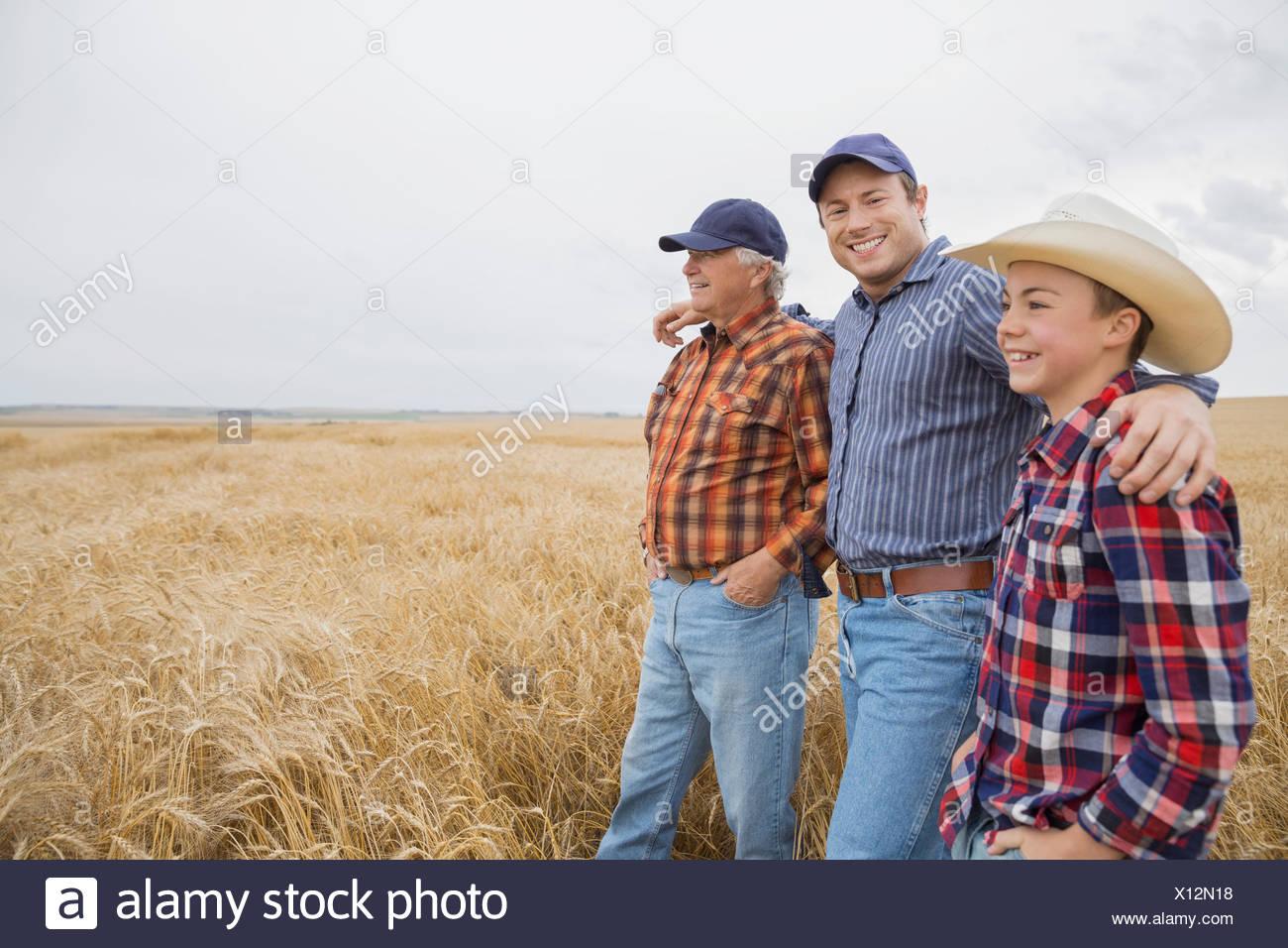Multi-generation men in wheat field - Stock Image