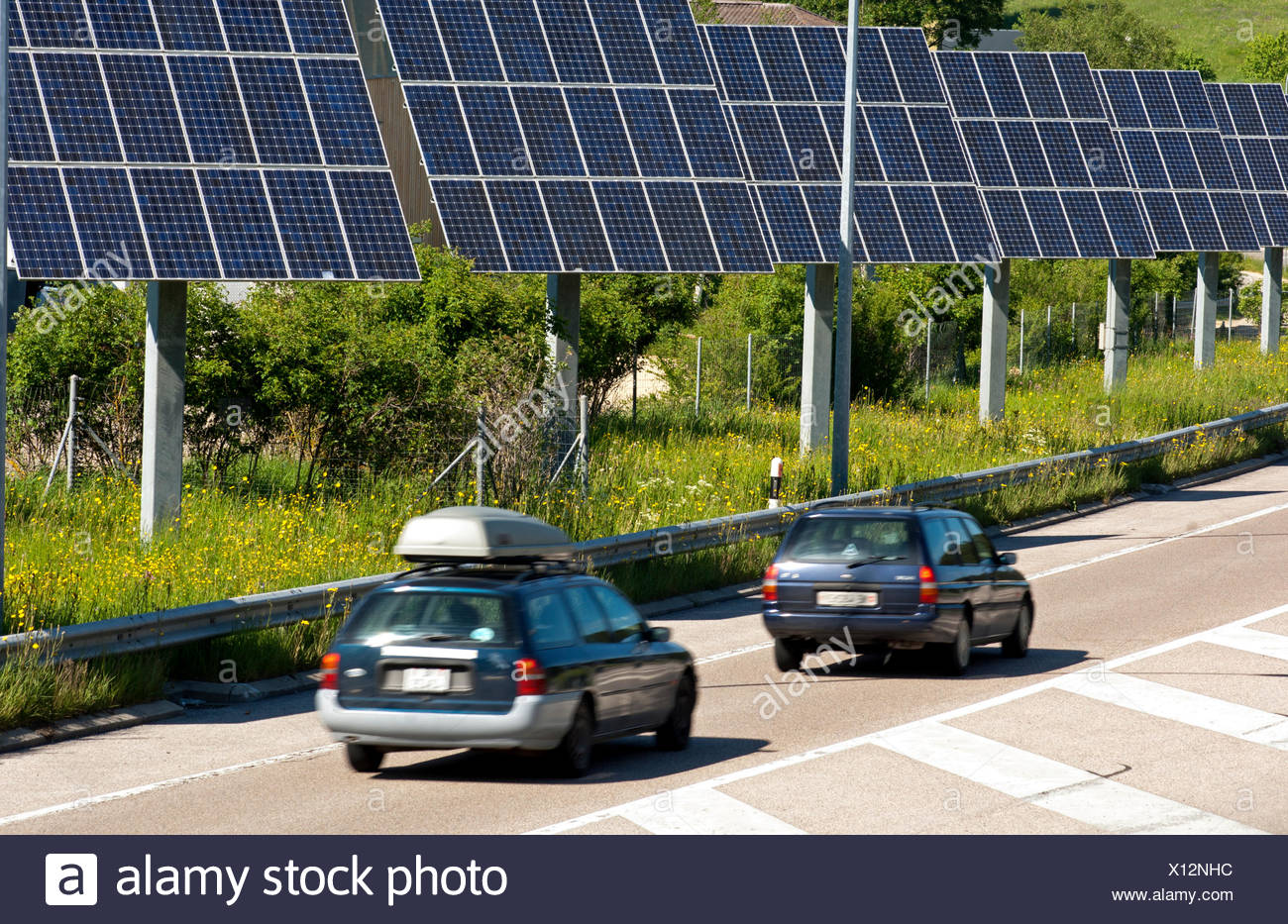 Photovoltaic modules along a country road in the Swiss Jura near La-Chaux-de-Fonds, Canton of Neuchâtel, Switzerland, Europe - Stock Image