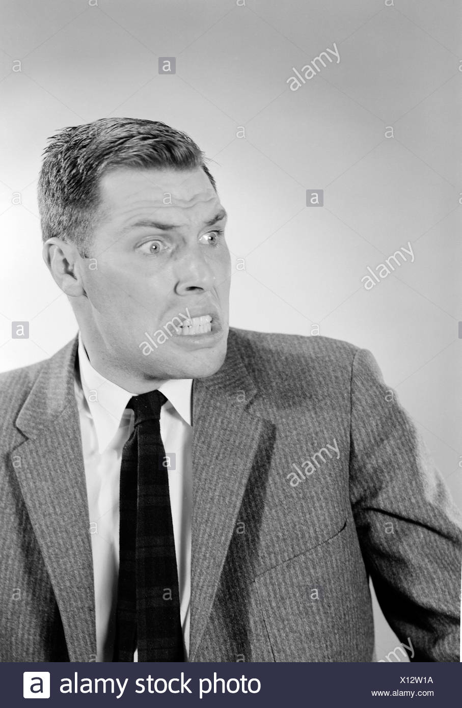 Portrait of furious young man - Stock Image