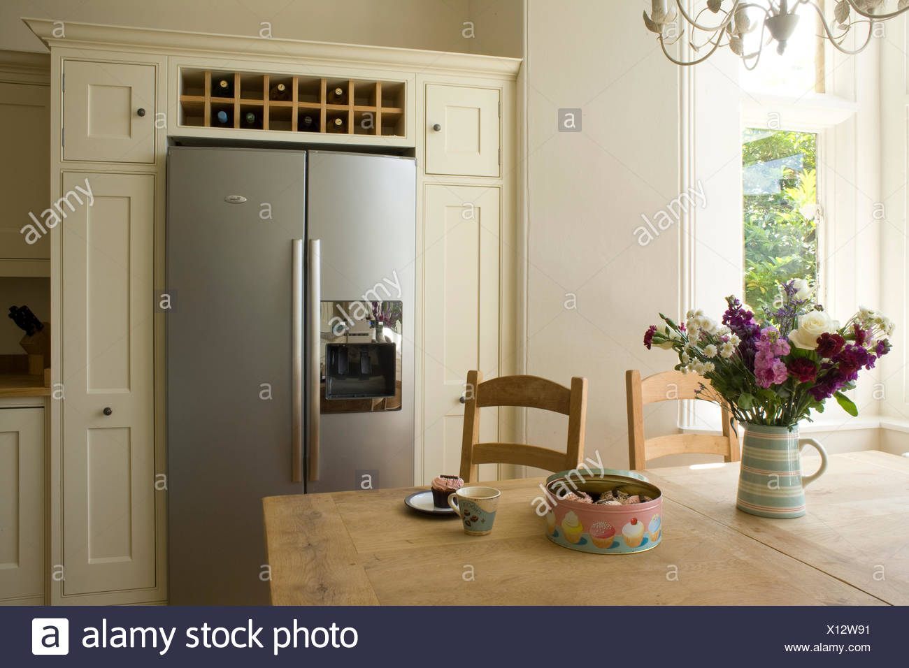 Vase Of Summer Flowers On Table In Country Kitchen With Wine