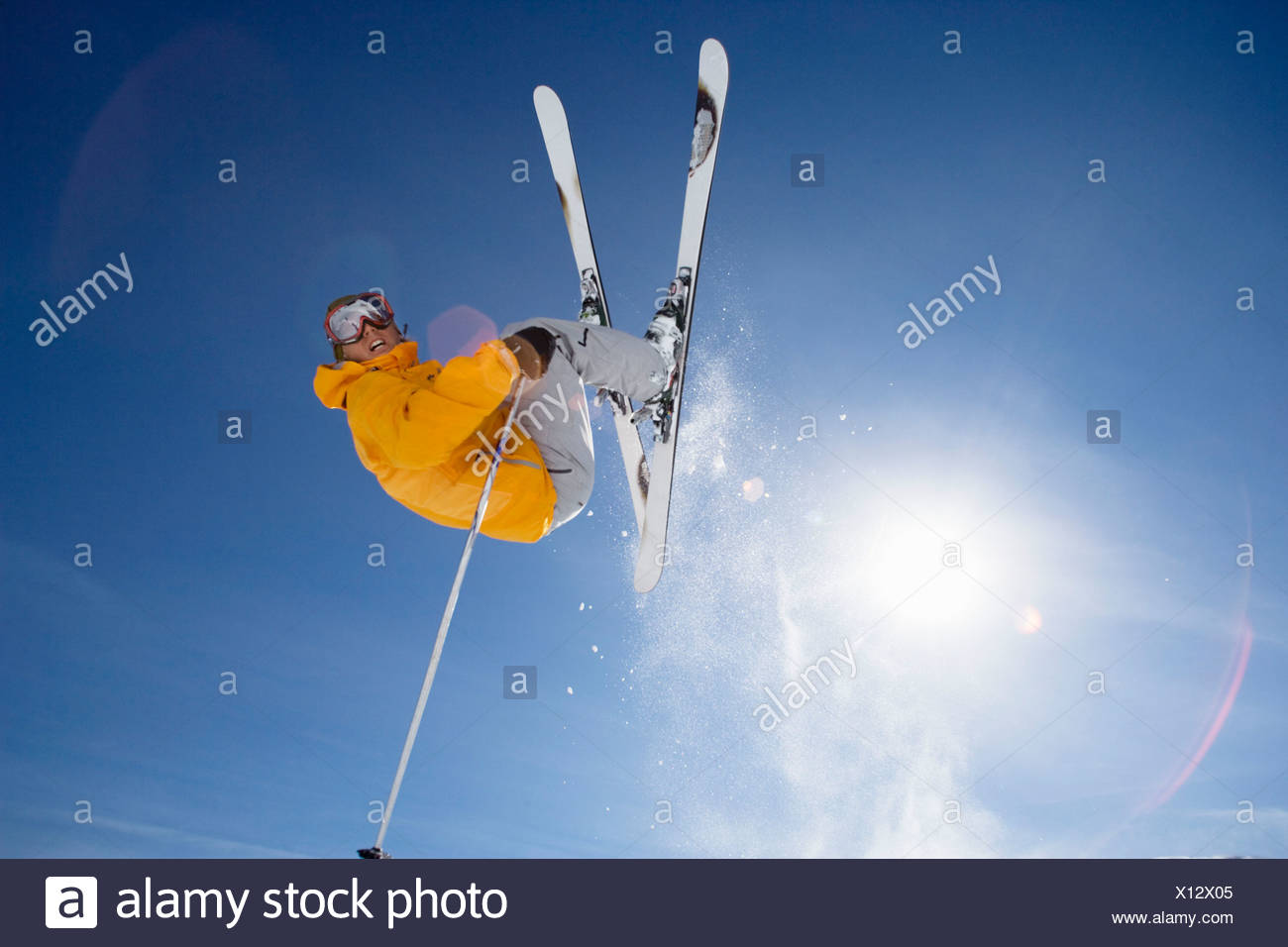 Skier jumping shot from bellow - Stock Image