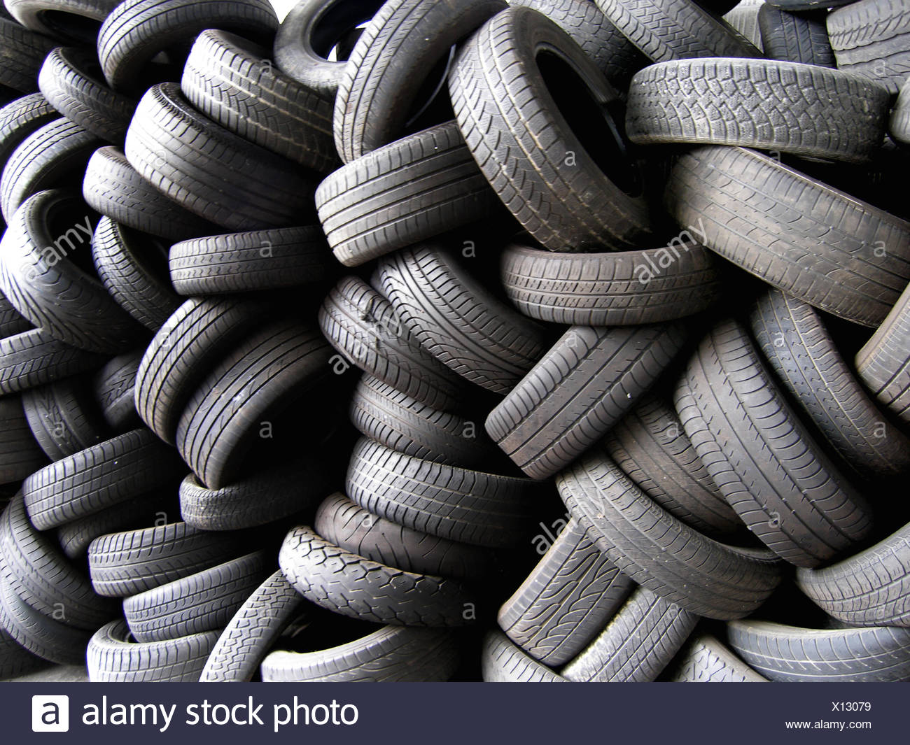 car tire garage tyre tire tyres profile stacked workshop snow tyre mull refuse Stock Photo