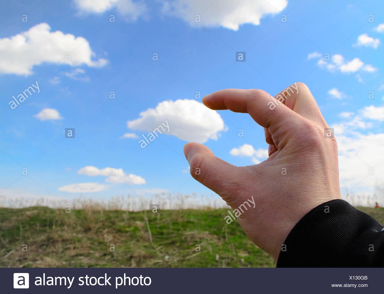 Grabing a cloud Stock Photo