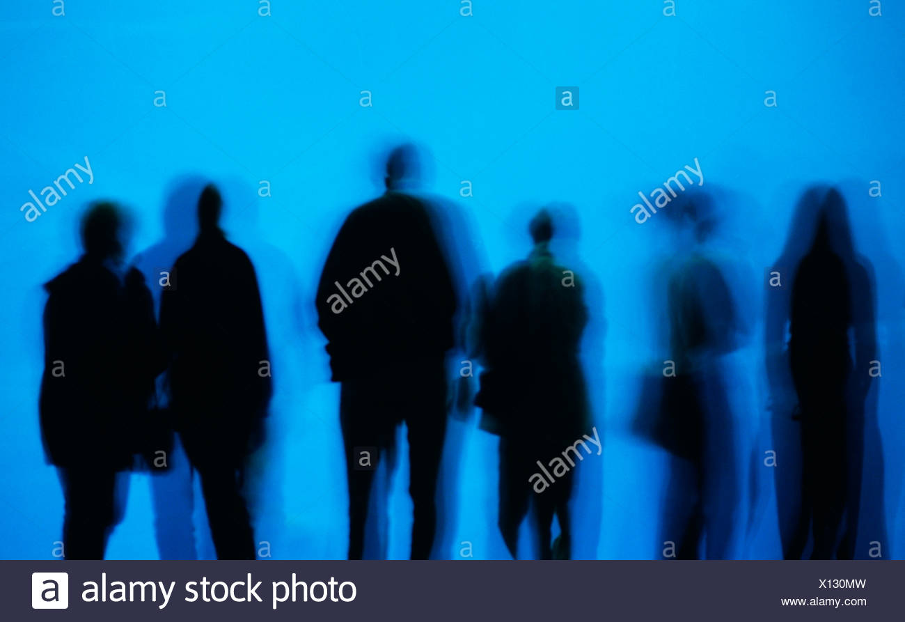 Silhouettes of people with ghost images - Stock Image