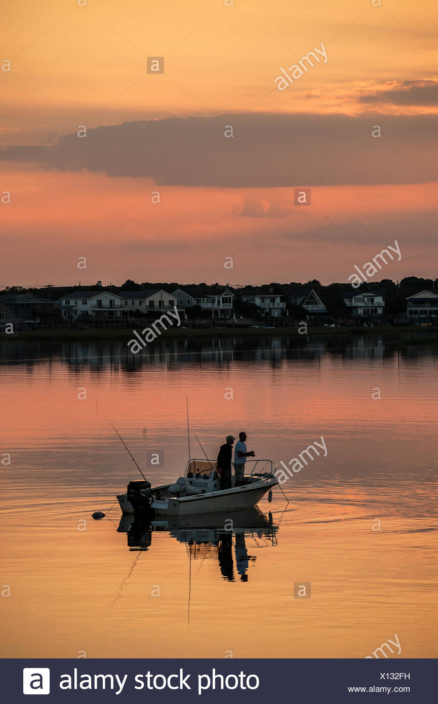 Saltwater fishing from boat in bay, Stone Harbor, New Jersey, USA - Stock Image