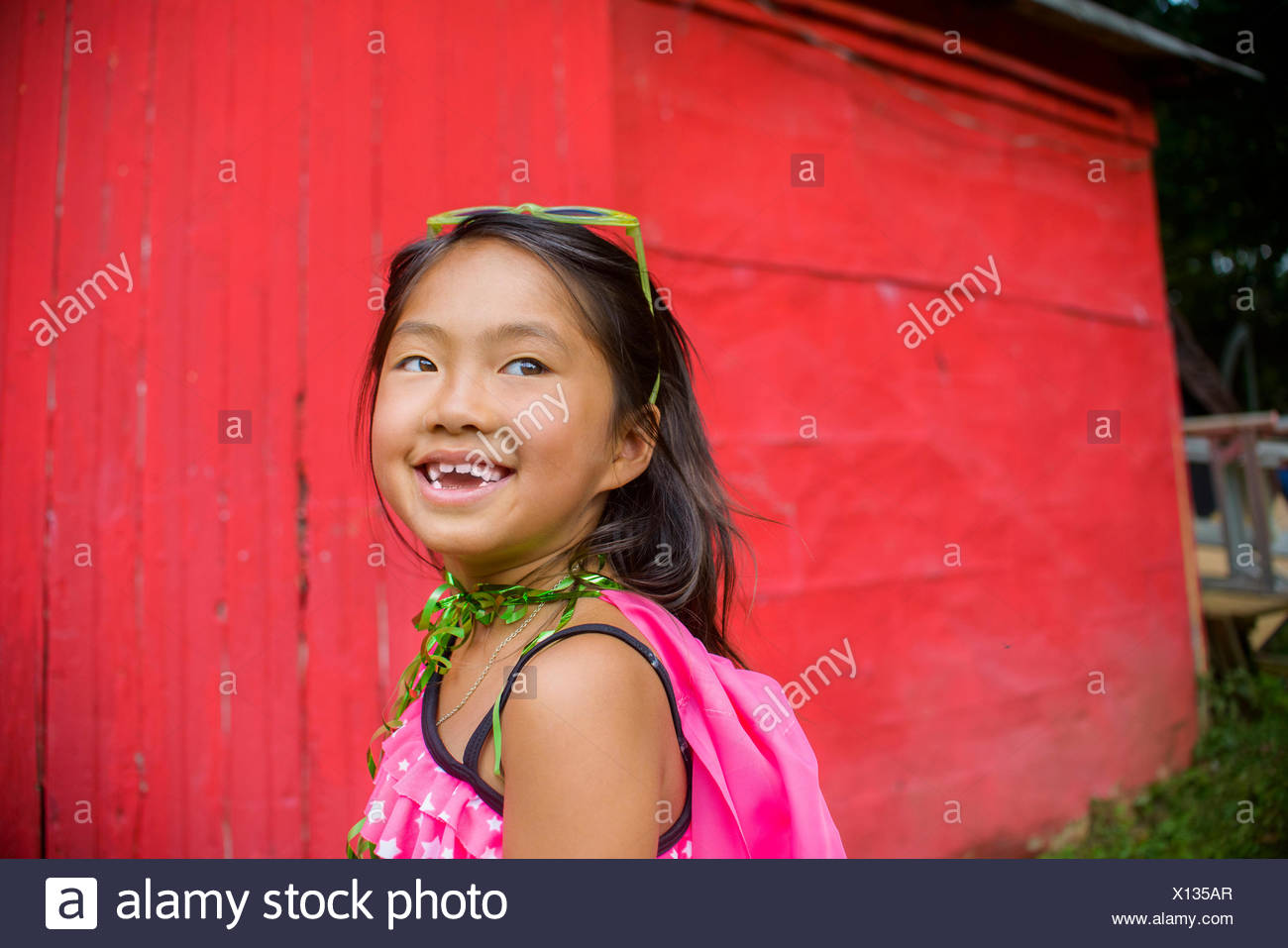 Portrait of young asian girl, looking away - Stock Image