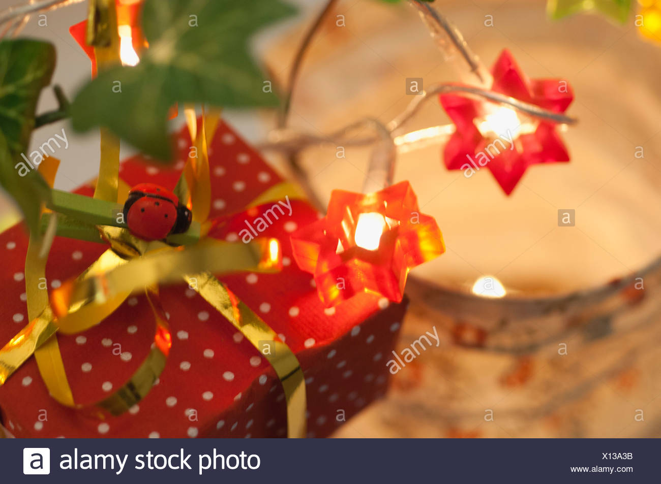 Festively wrapped Christmas present - Stock Image