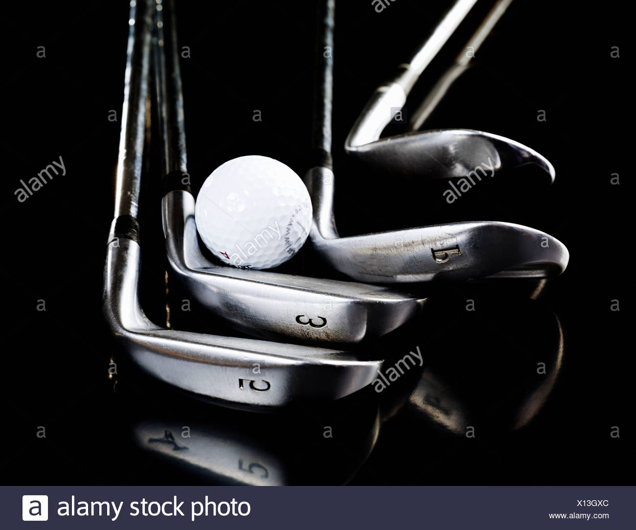 Golf clubs and ball - Stock Image
