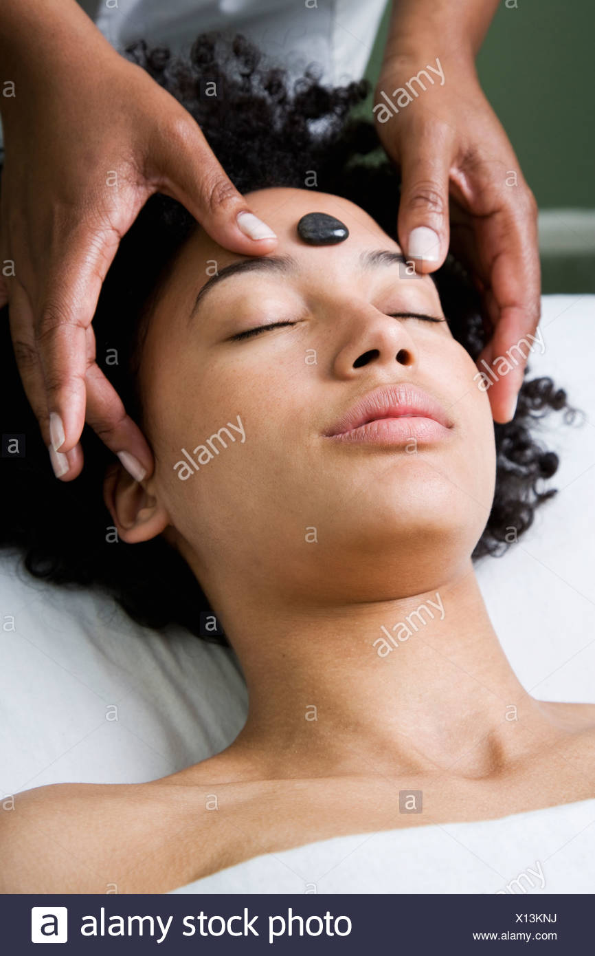 USA, California, Oakland, young woman receiving stone spa treatment Stock Photo