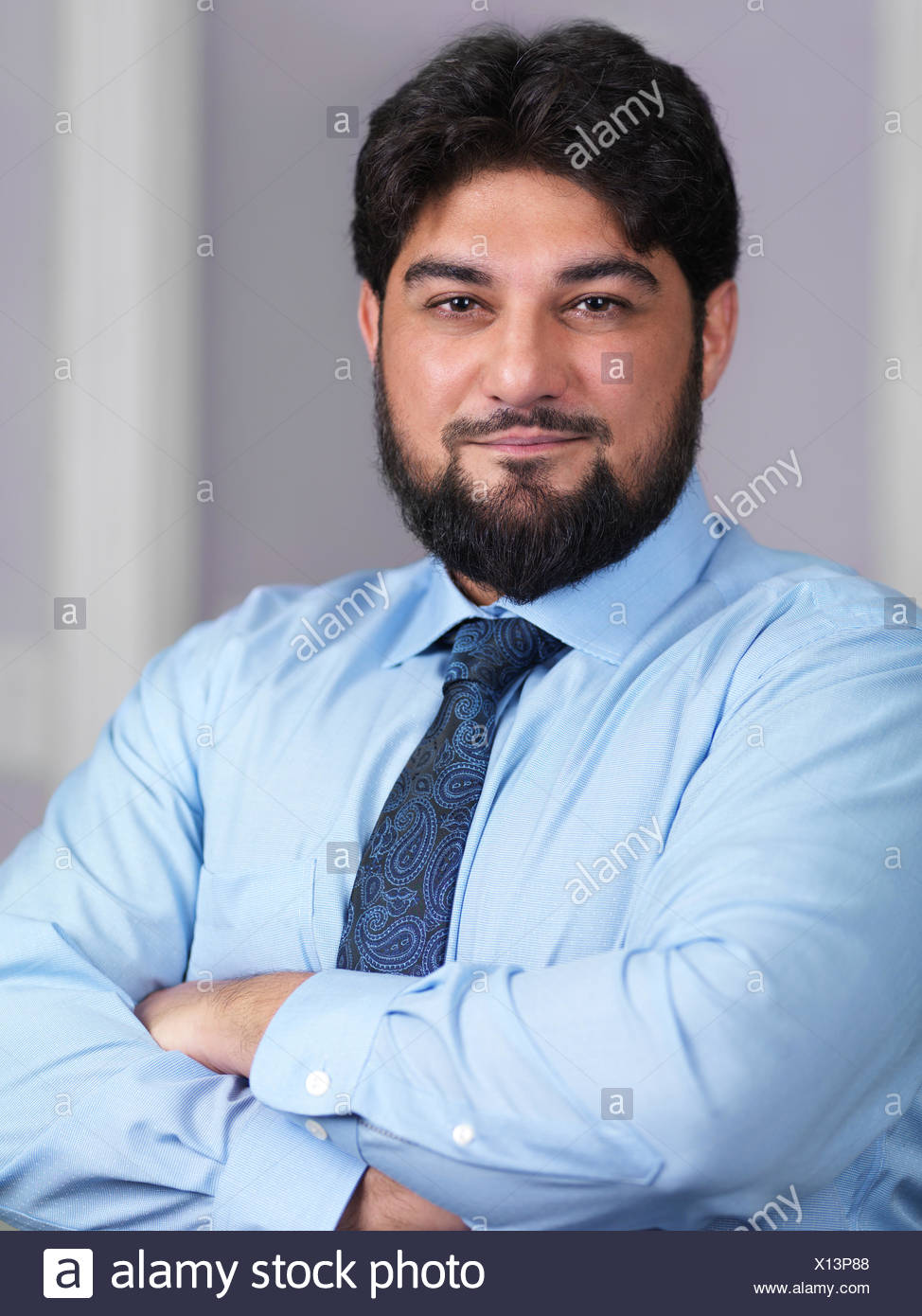 Portrait of a smiling businessman in his thirties - Stock Image