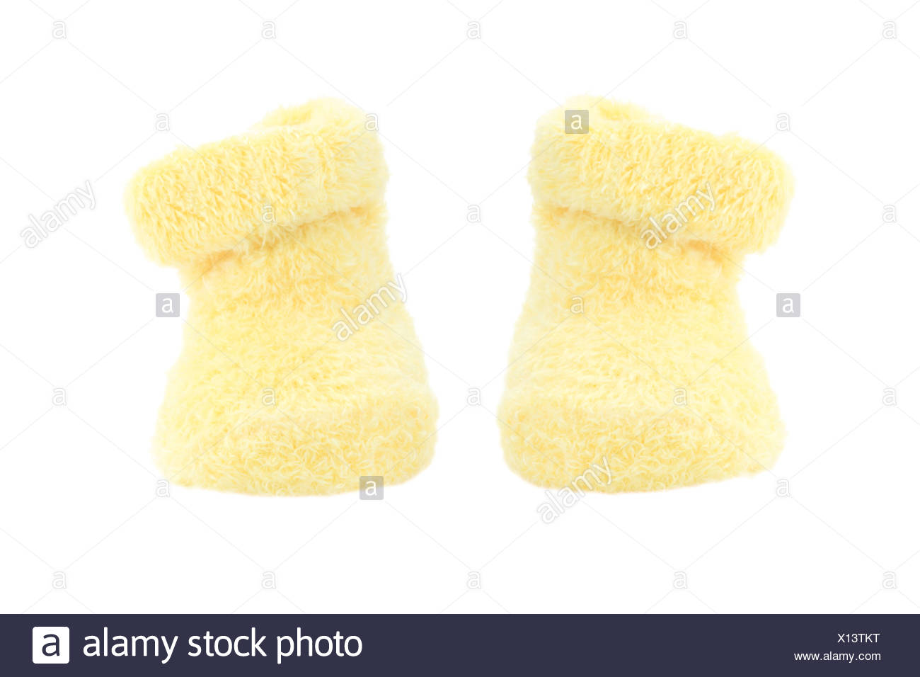 a5f1924f4 Cute little yellow baby booties isolated on white Stock Photo ...