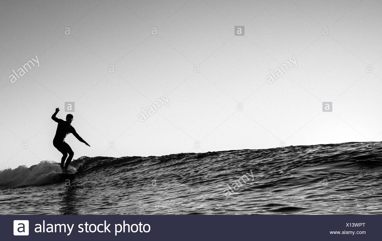 Surfer on wave - Stock Image
