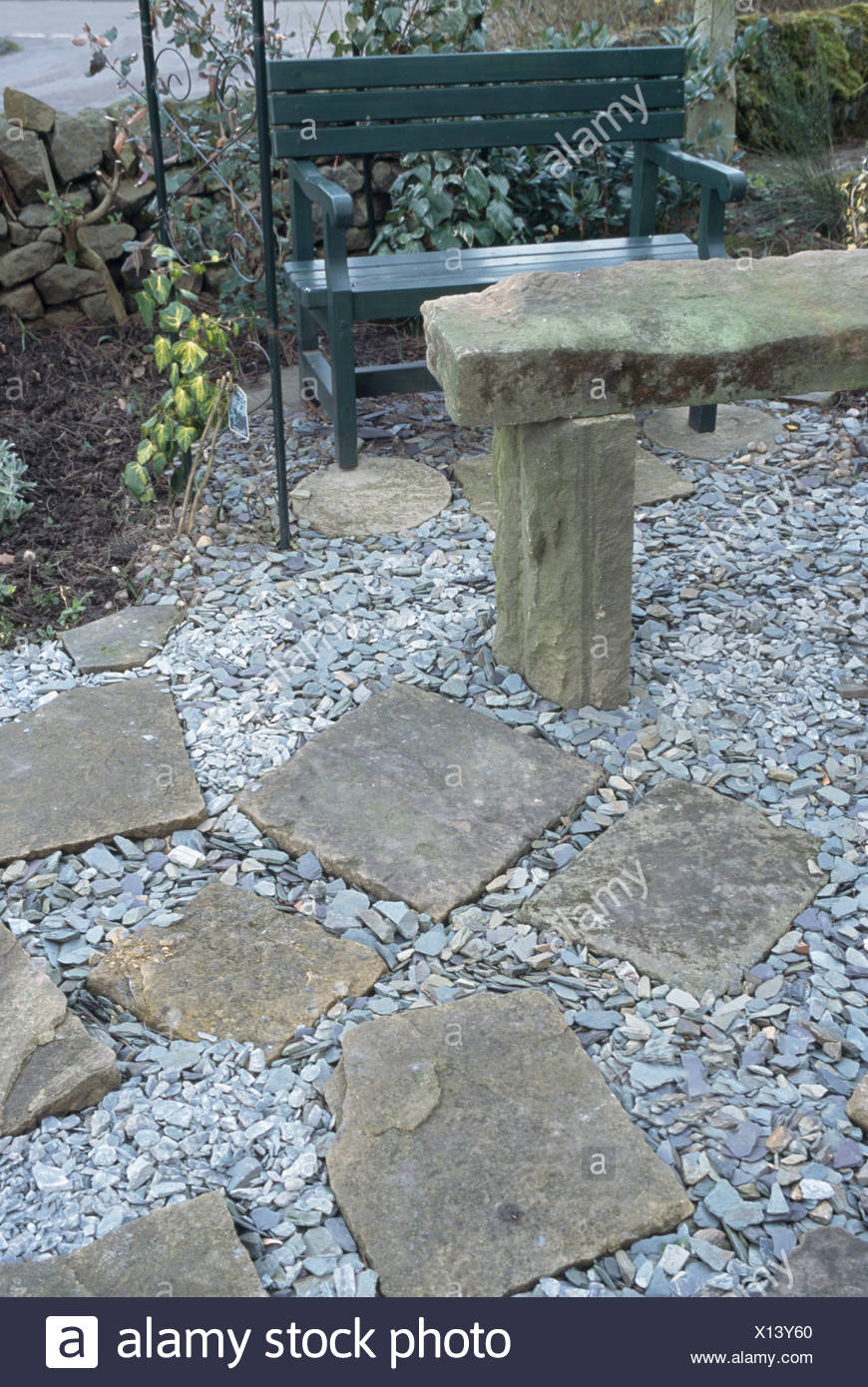 Super Rustic Stone Table And Metal Bench On Gravel Patio With Machost Co Dining Chair Design Ideas Machostcouk