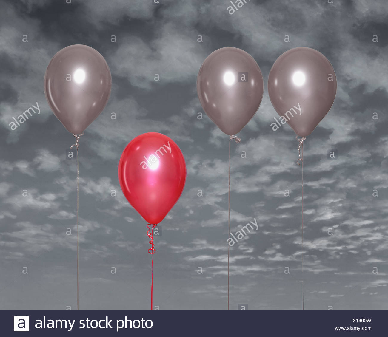 Red balloon standing out - Stock Image