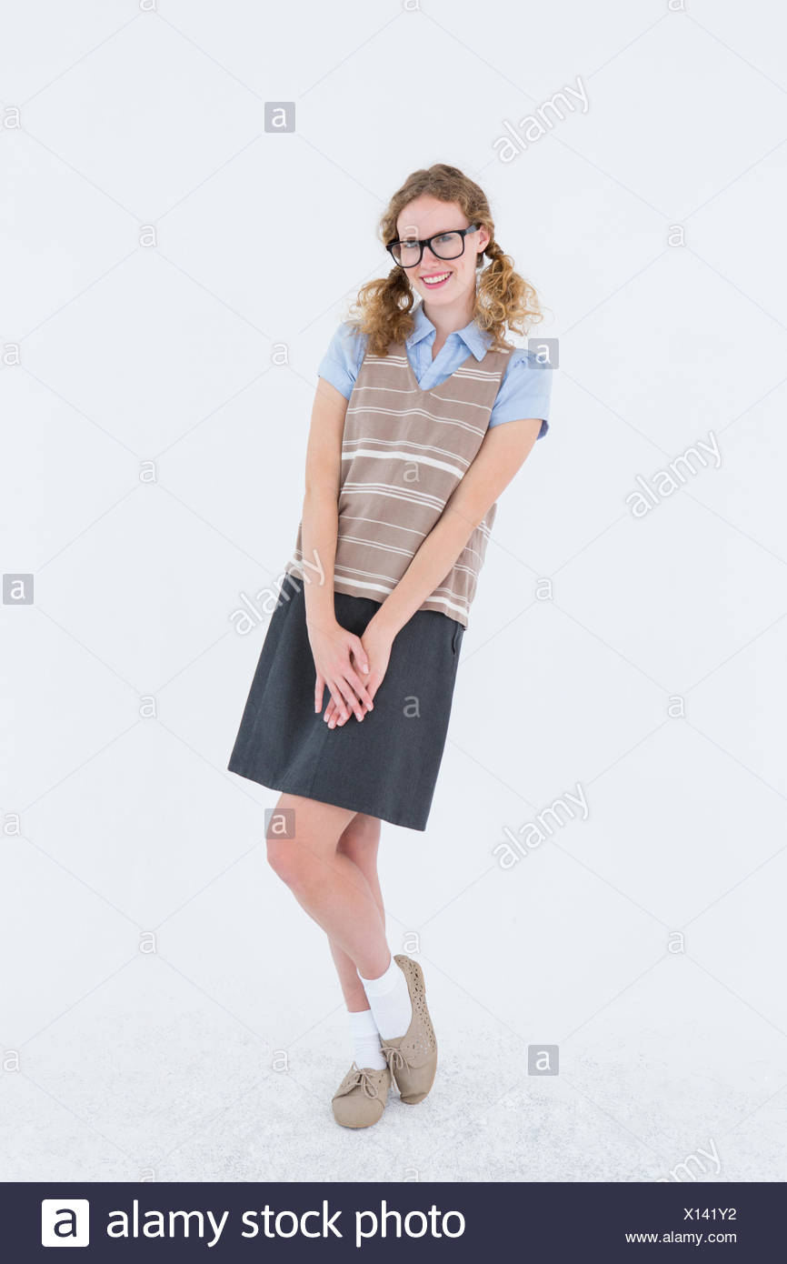Geeky hipster woman smiling at camera - Stock Image