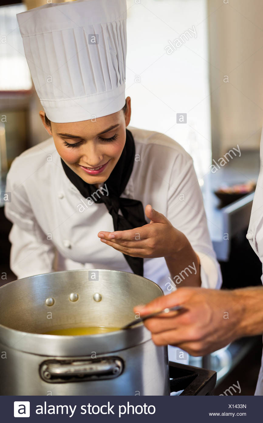 Head chef smelling the food - Stock Image