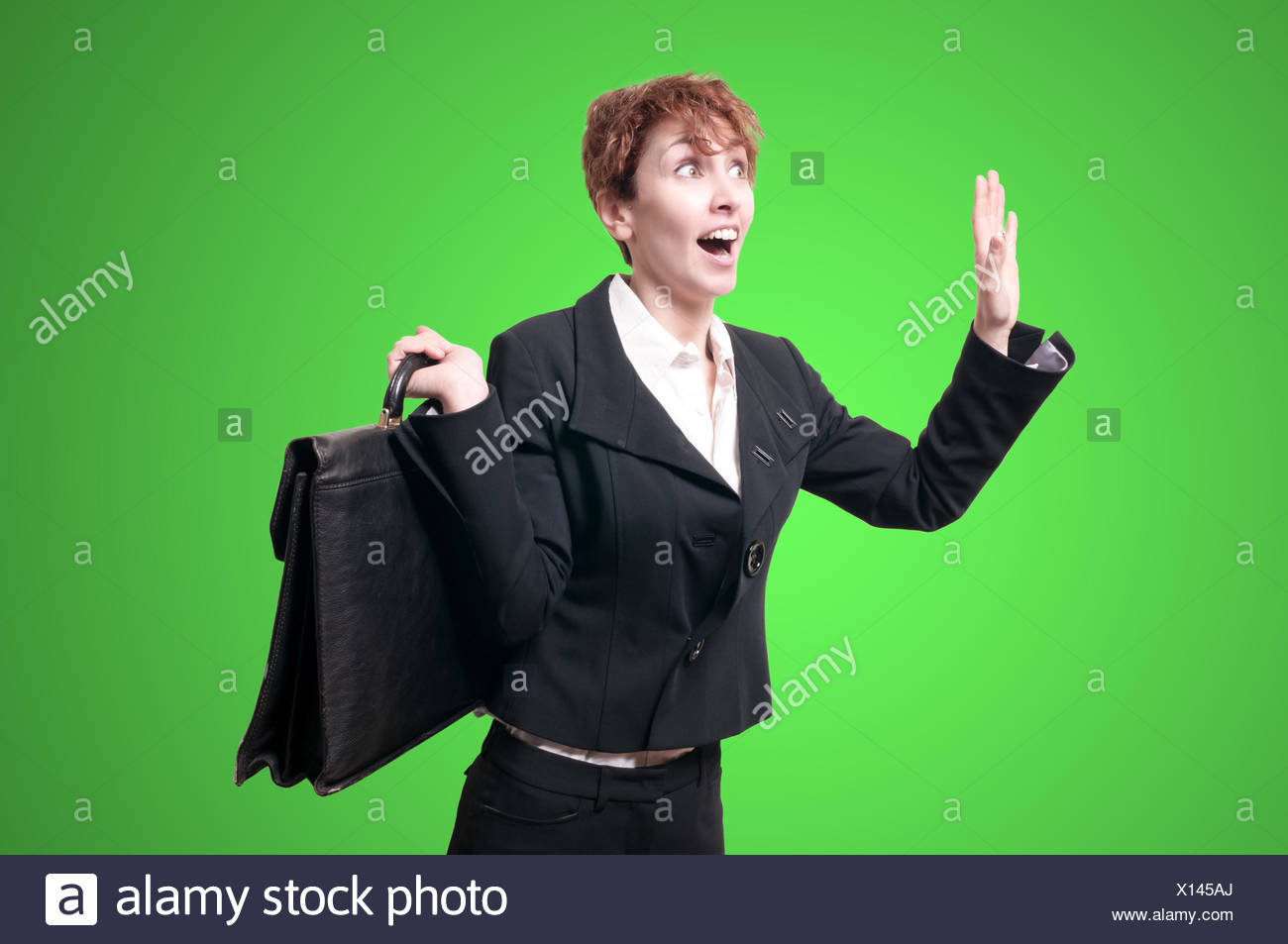 astonished business woman with briefcase - Stock Image