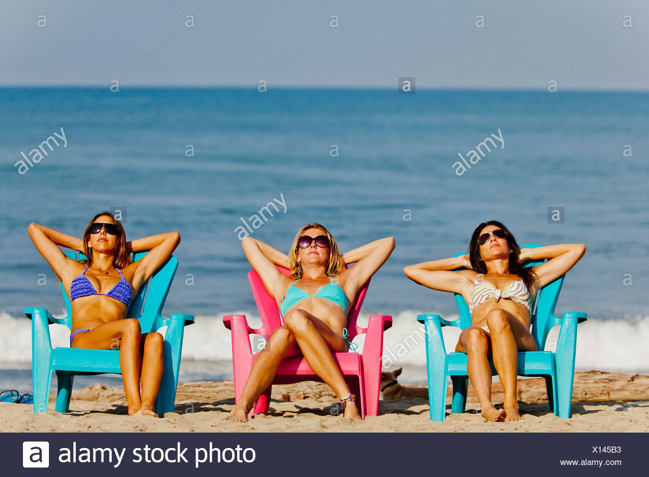 Swell Three Women Lounging On Beach Chairs Stock Photo 276072583 Ocoug Best Dining Table And Chair Ideas Images Ocougorg