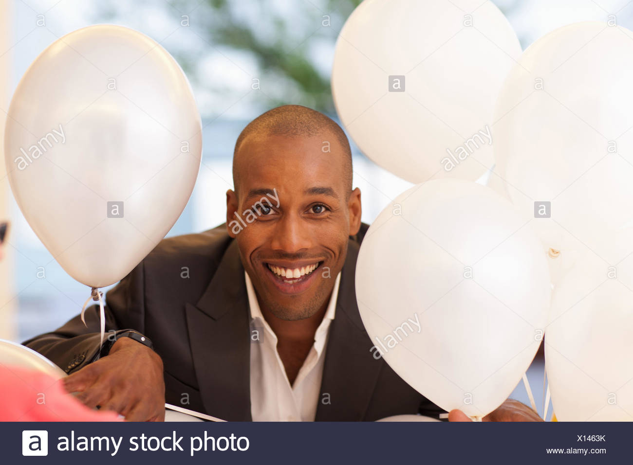 Man with balloons - Stock Image