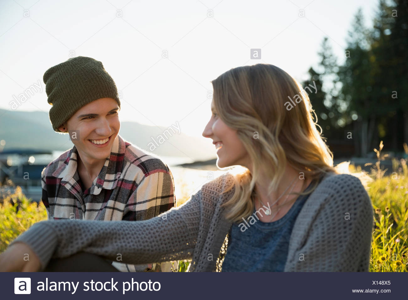 Young couple talking outdoors - Stock Image