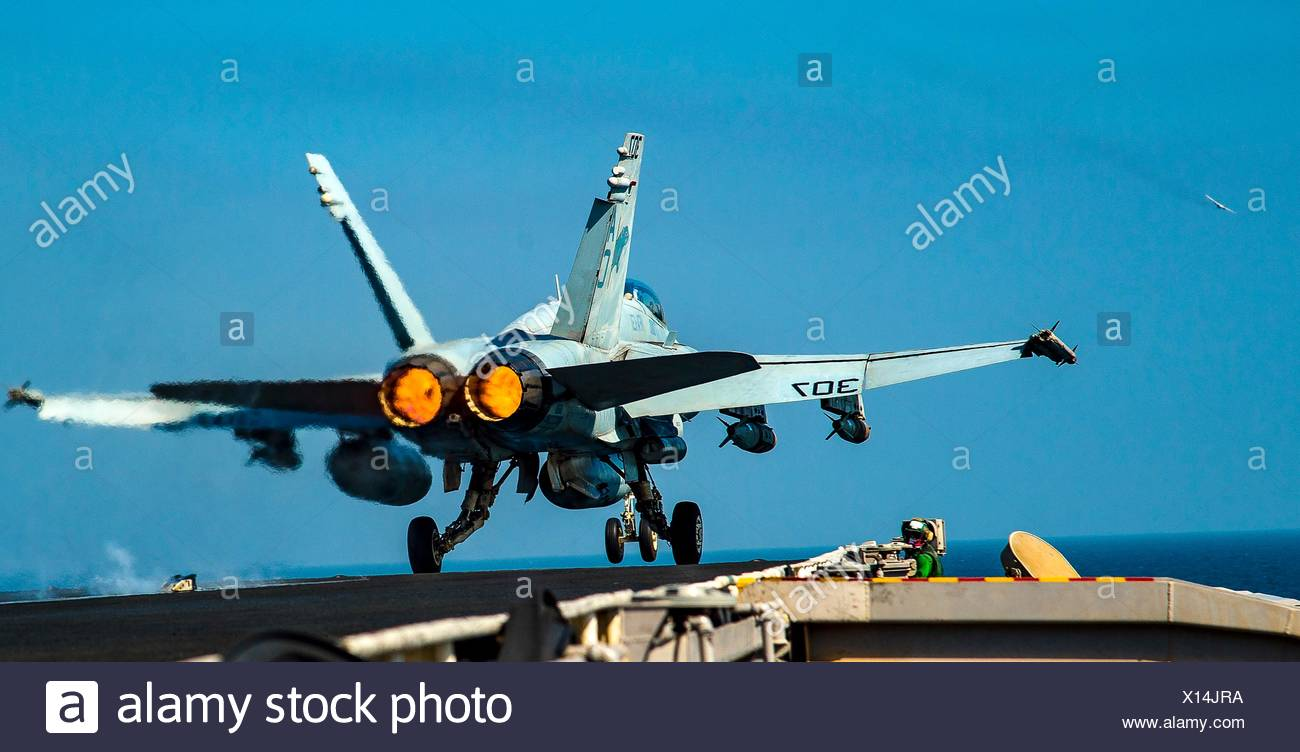ARABIAN GULF (Oct. 16, 2016) An F/A-18C Hornet assigned to the Wildcats of Strike Fighter Squadron (VFA) 131 launches from the flight deck of the - Stock Image
