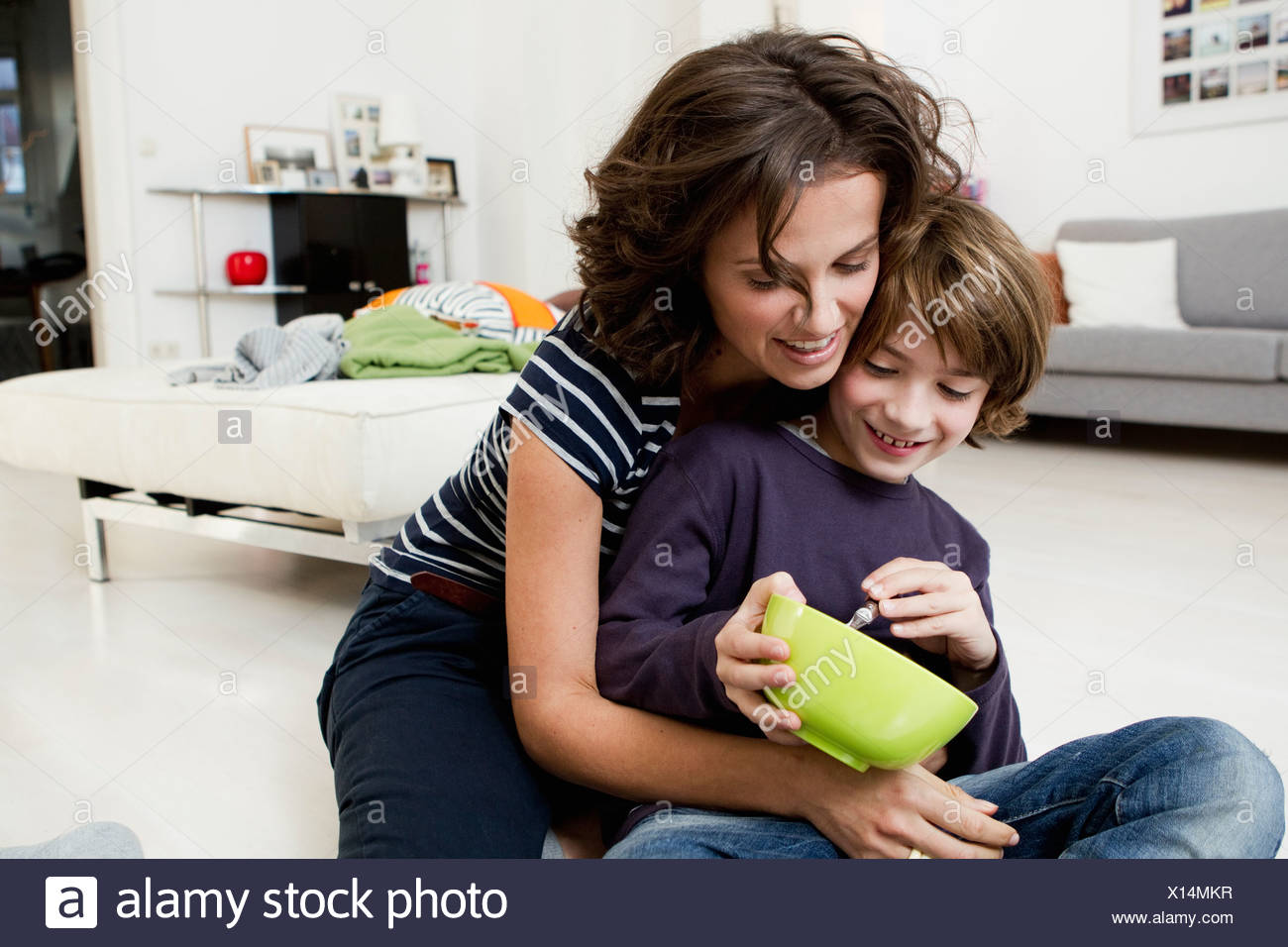 Mother and son relaxing in living room Stock Photo