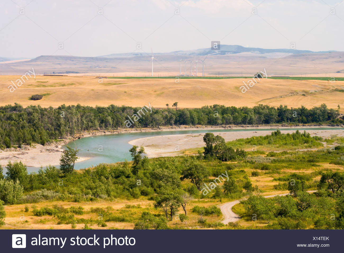 Wind turbines, Pincher Creek, Alberta, Canada, river, energy, alternate Energy - Stock Image