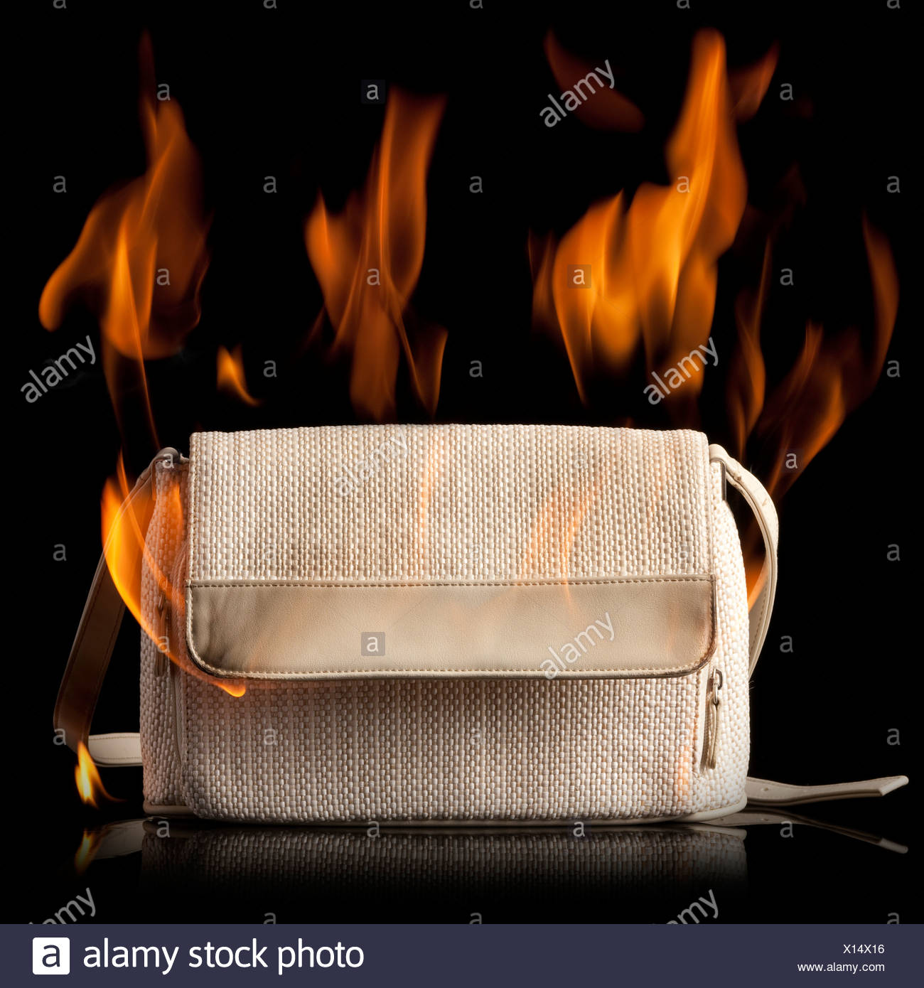 purse on fire - Stock Image
