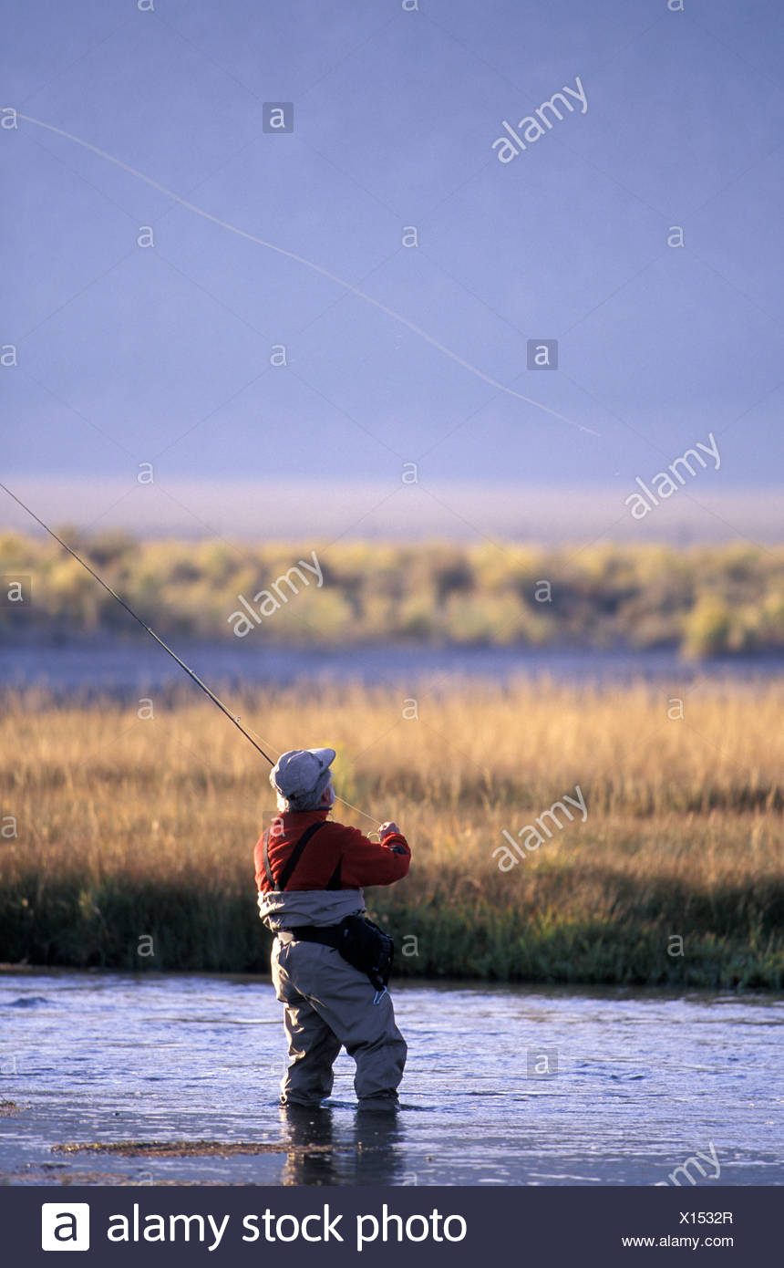 Man fly fishing on the Owens River near Mammoth Lakes
