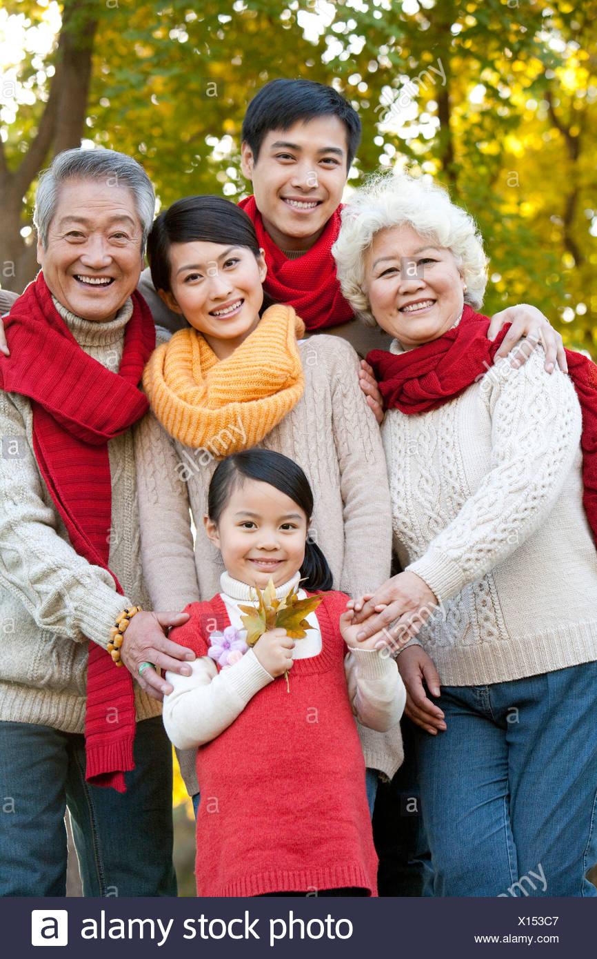 Multi Generation Familiy Enjoying a Park in Autumn - Stock Image