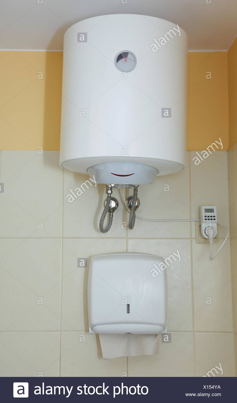 Paper Towel Dispenser And Electric Water Heater On The Wall In The Bathroom Stock Photo Alamy