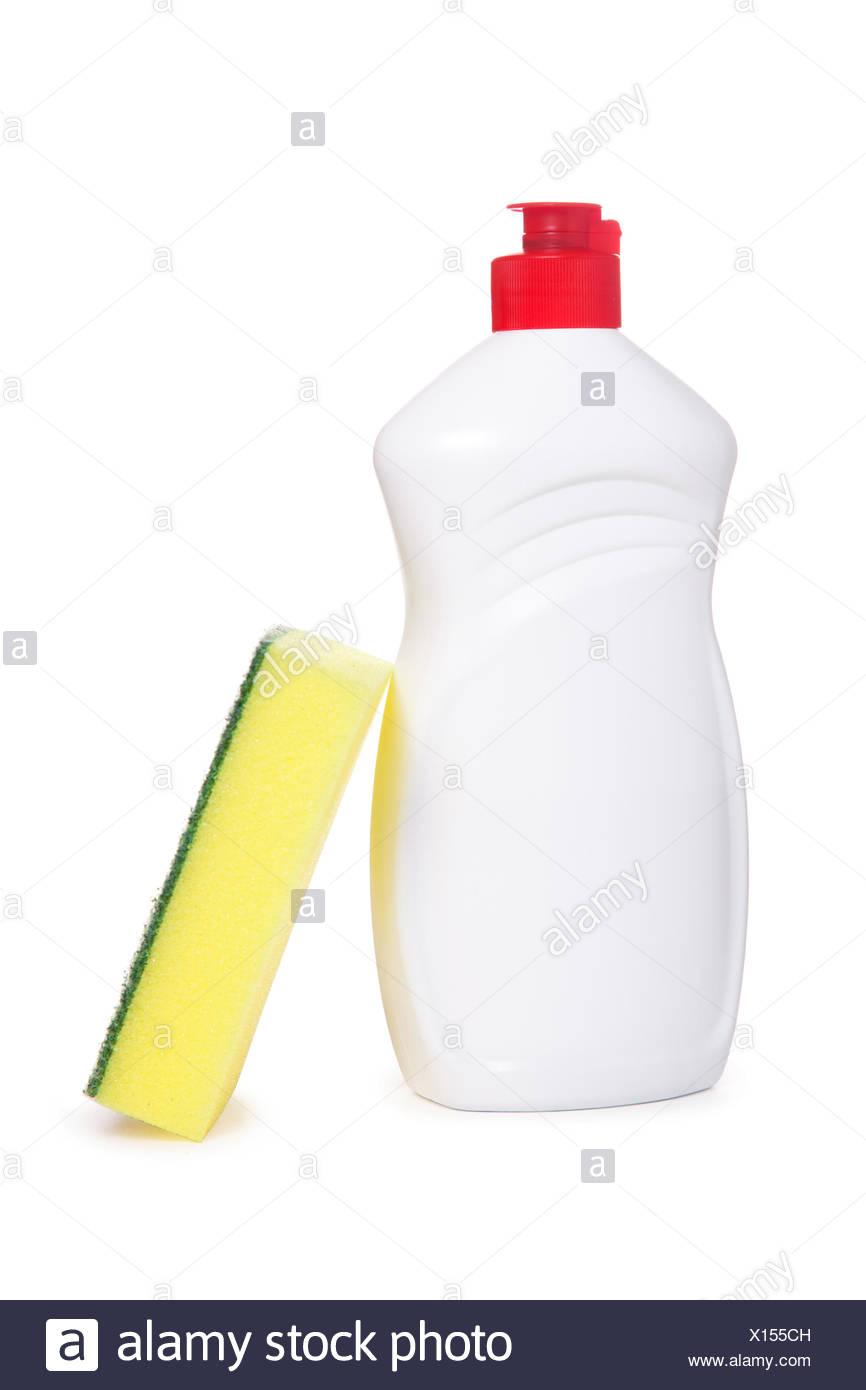 Yellow kitchen sponge and bottle of dishwashing li - Stock Image