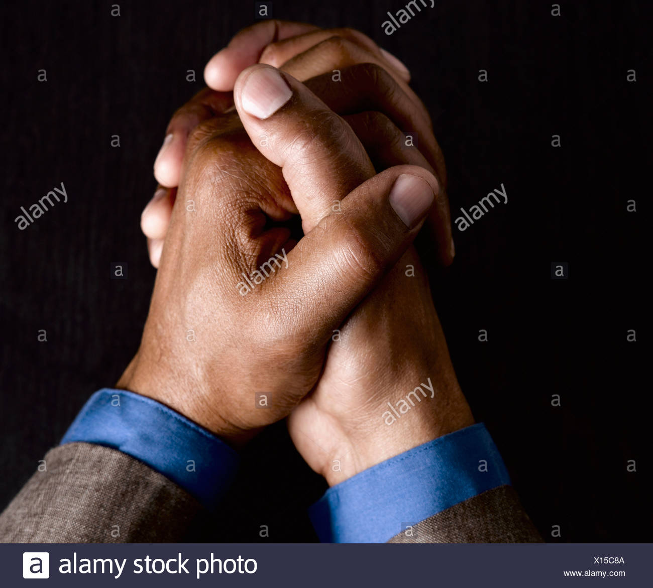 Business man with hands clasped together Stock Photo