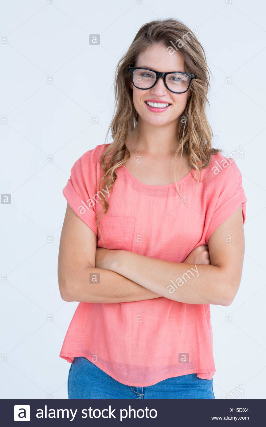 Pretty geeky hipster smiling at camera - Stock Image