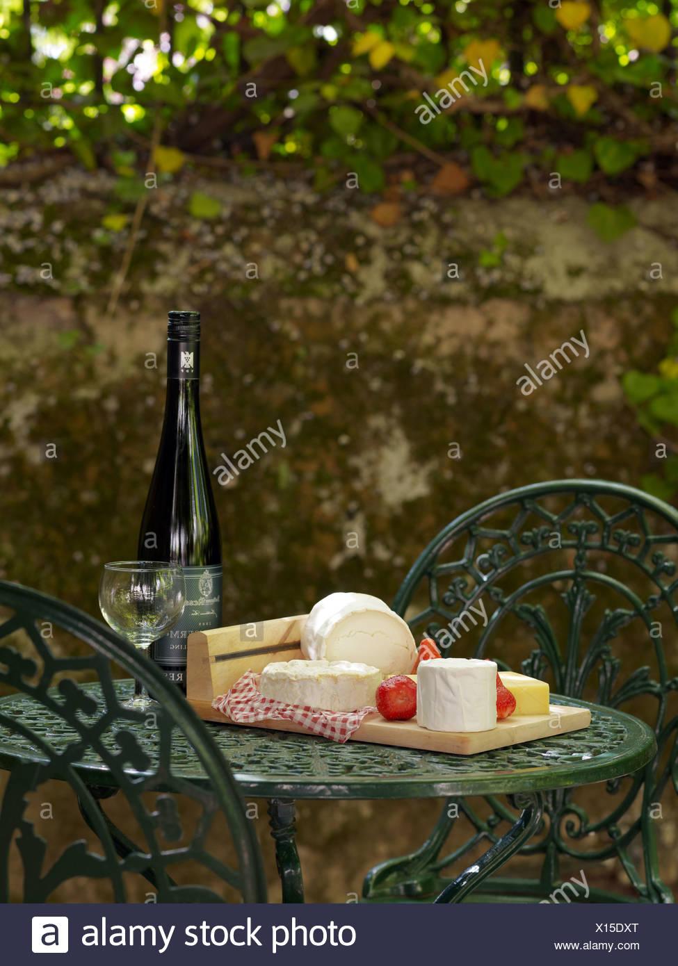 Still Life Cheese Buffet And Wine On A Cast Iron Garden