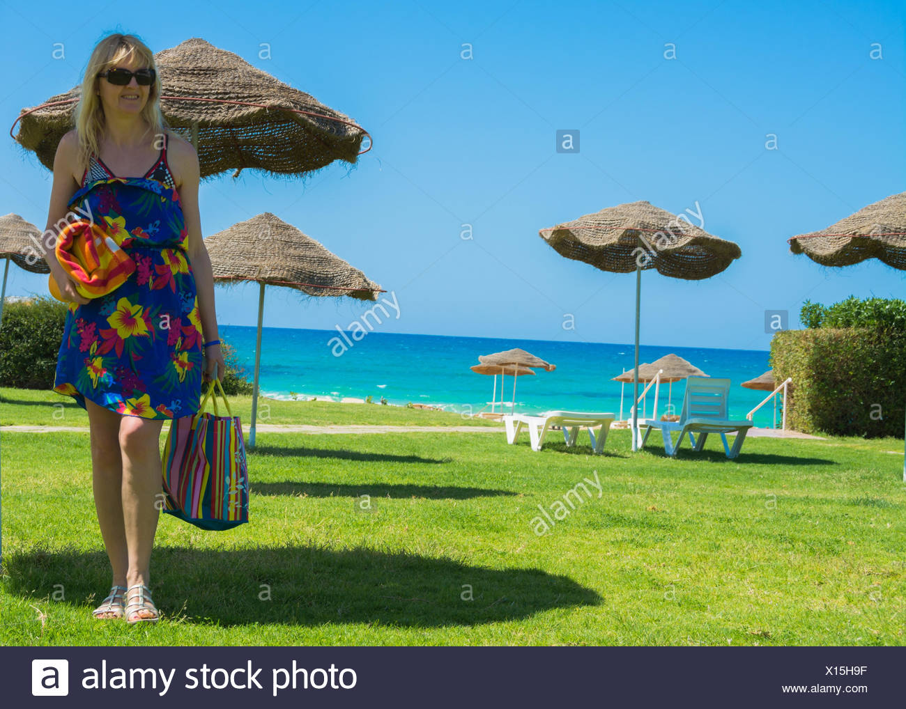 Holidaymaker at Tunisian beach - Stock Image