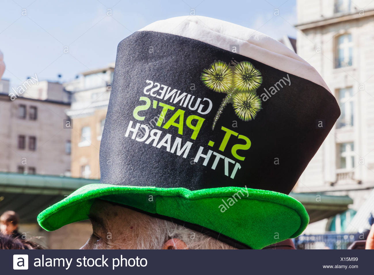 England, London, St.Patrick's Day Parade, Parade Spectator Wearing Guinness Top Hat - Stock Image