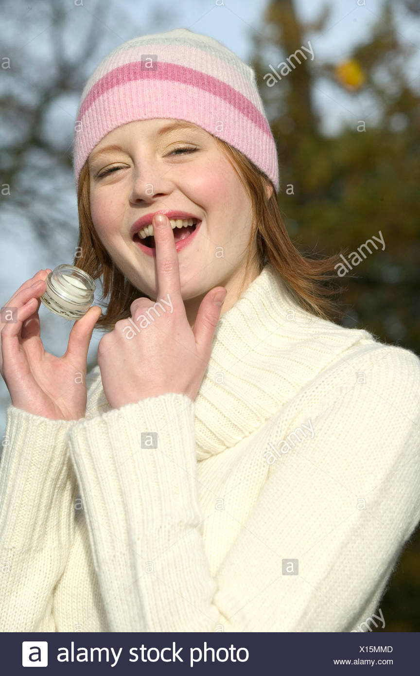 85354631b3c Female shoulder length red hair wearing pink and white striped wool hat and  white turtle neck jumper