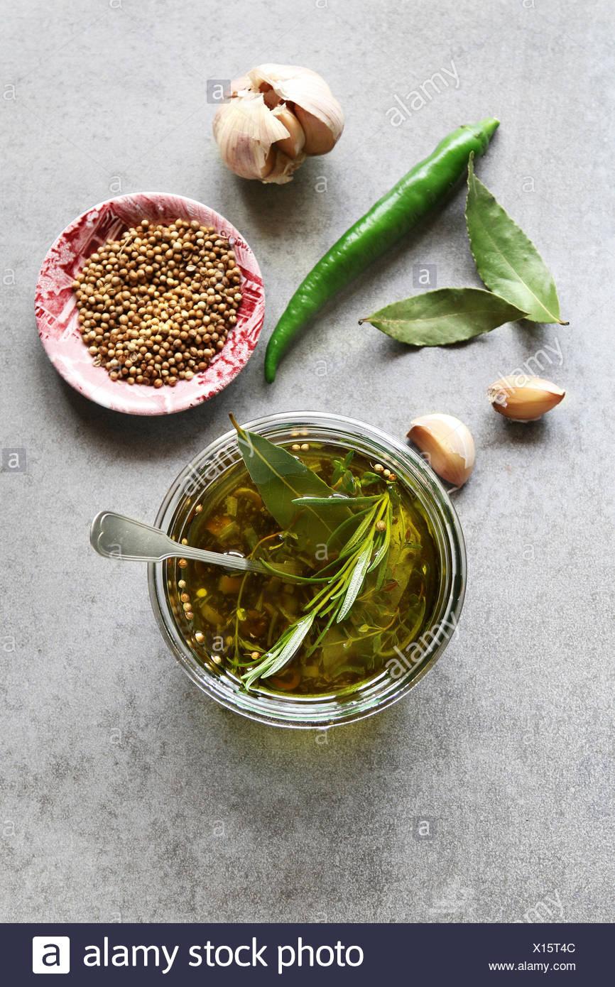 Marinade made from garlic,chilli,coriander and rosemary.Top view - Stock Image