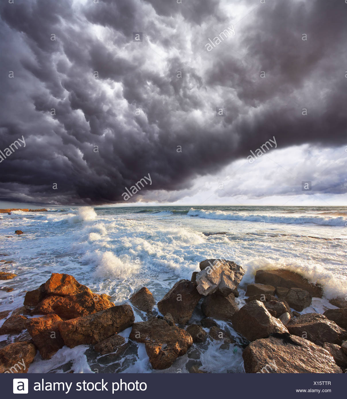 The storm cloud over the raging surf - Stock Image