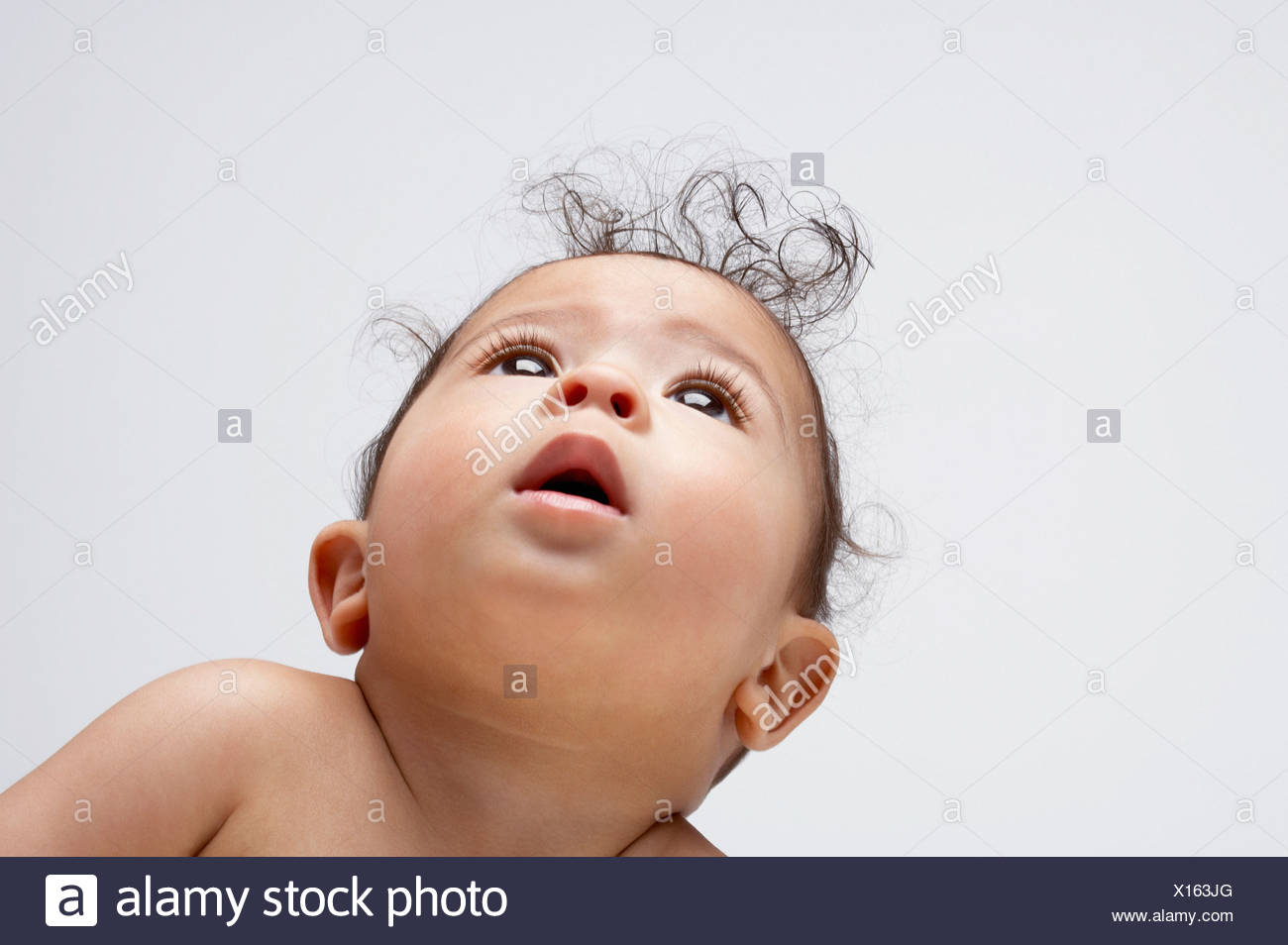 A baby boy looking up - Stock Image