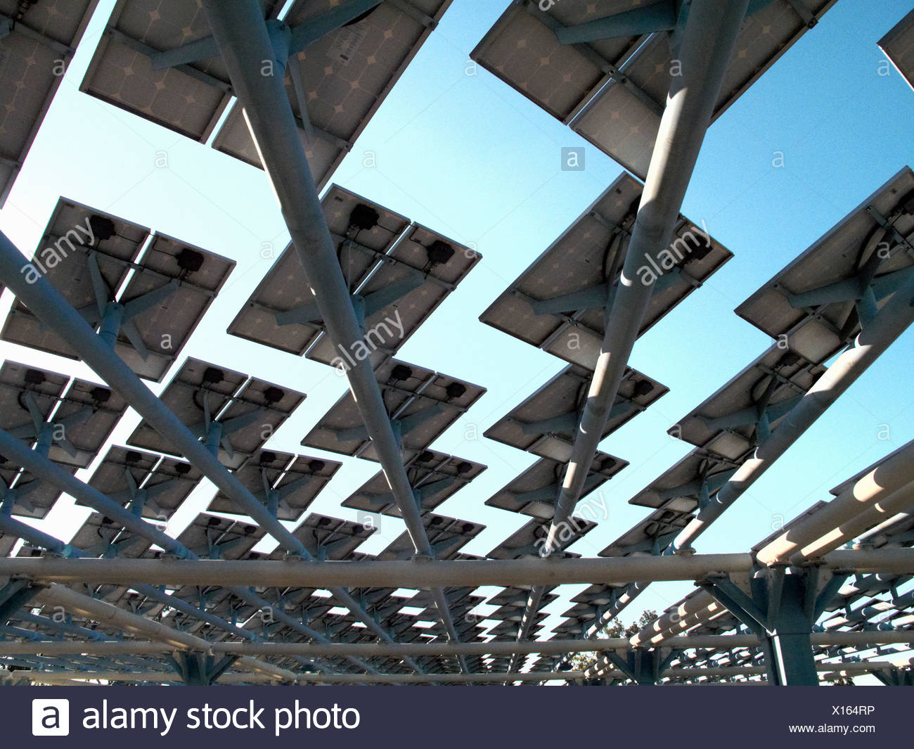 Solar panels creating shade on roof - Stock Image