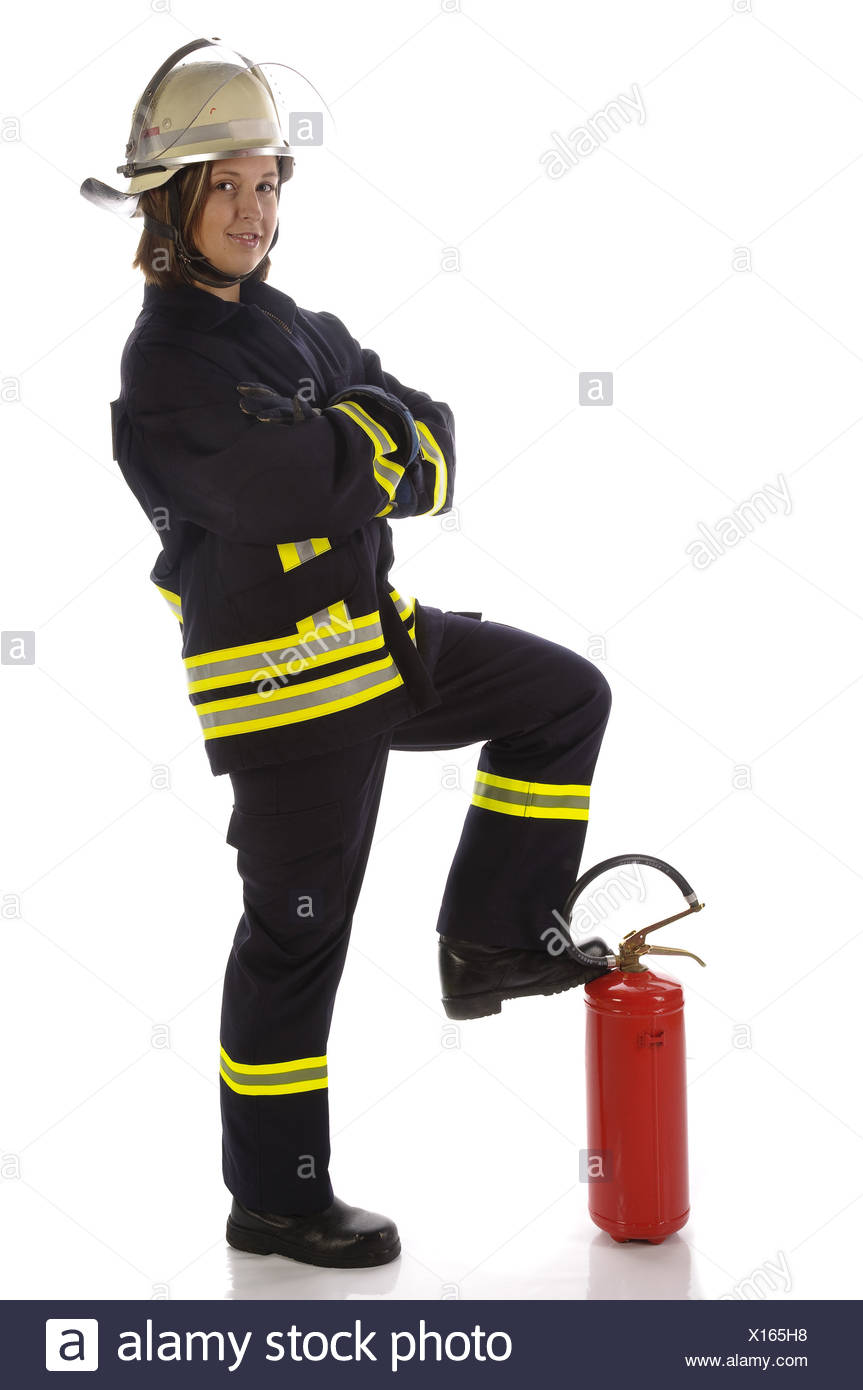 Young firefighter in uniform - Stock Image