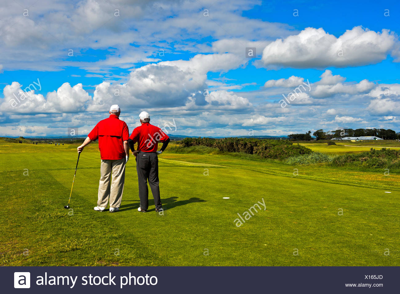 Two golfers on the Jubilee Course, St Andrews Links, St Andrews, Fife, Scotland, United Kingdom - Stock Image