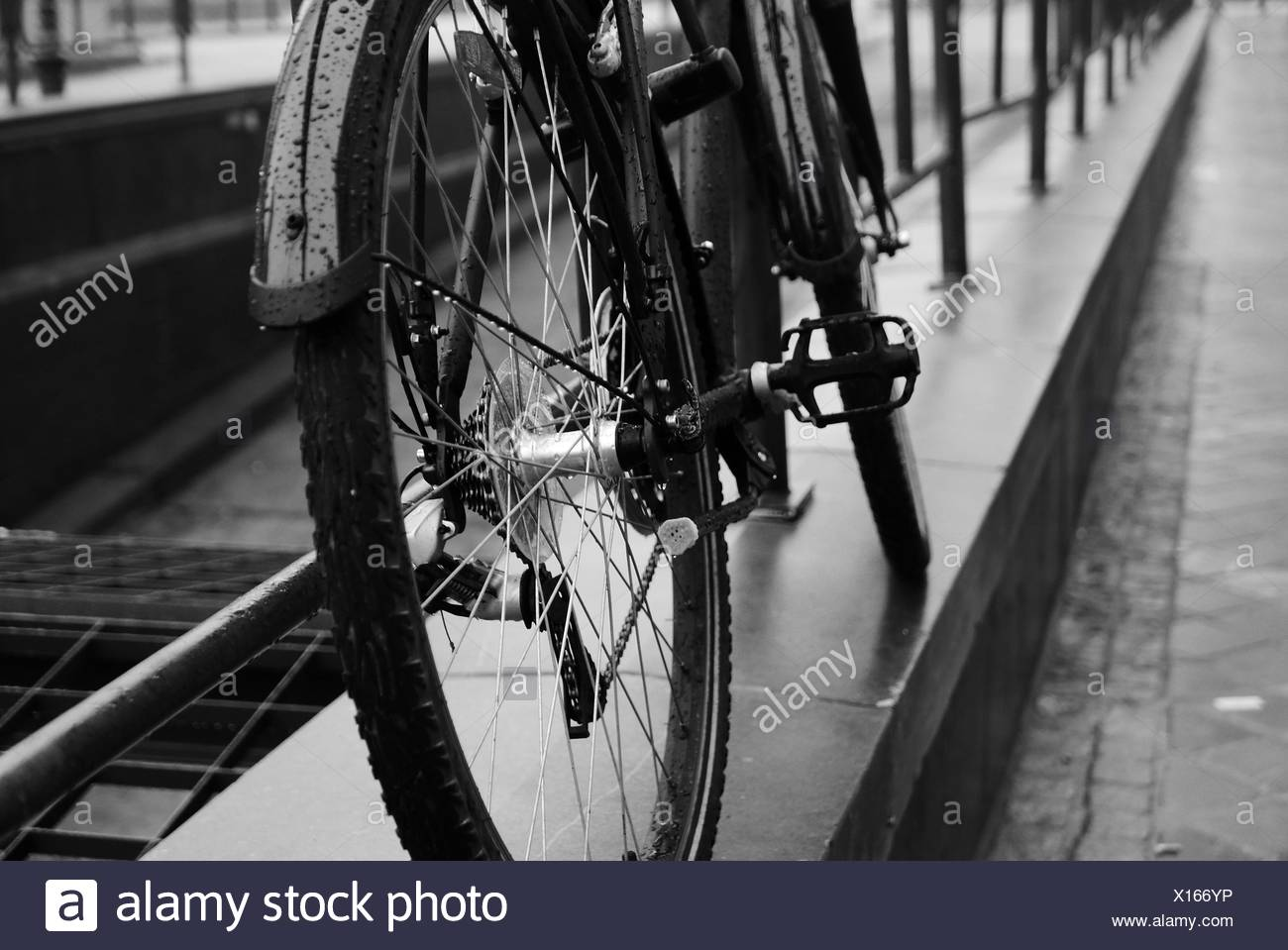 High Angle View Of Bicycle Parked At Railing - Stock Image